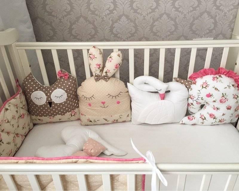 Бортики в кроватку для новорожденных: фото, особенности выбора