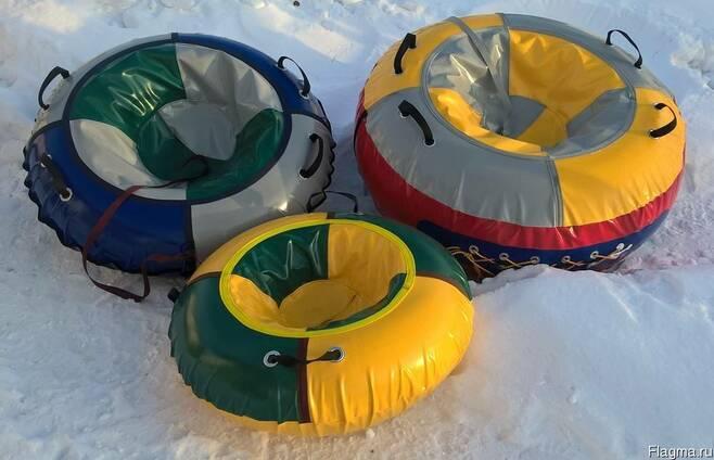 Двойной тюбинг: выбираем двухместную ватрушку для катания по снегу. лучшие модели двойных надувных санок. как их хранить?
