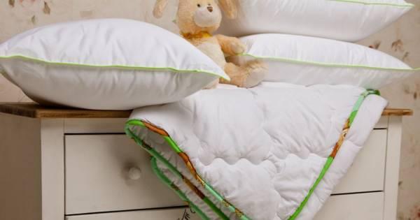 Одеяло в кроватку для новорожденного: размер, наполнитель
